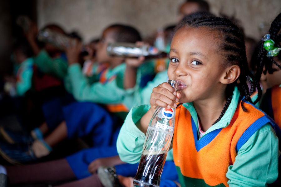 Young Girl Drinks a Pepsi at the Fasilides Castle in Gondar, Ethiopia by Lane Davis